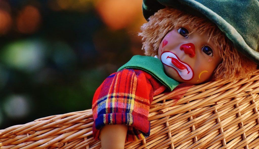 Sad Clown Doll in a Basket